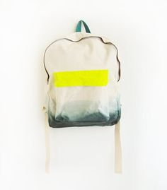 -The small amount of neon is bold and bright without drowning out the rest of the bag or looking tacky -The ombre/dip dyed look is on trend and gives this backpack a free-spirited and urban feel -The simple design and lack of print make it easy for imprinting upon