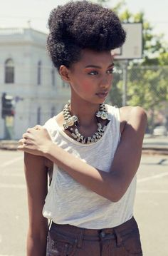 This girl sports the prettiest Afro updo