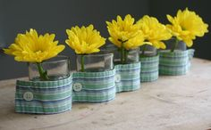Flower vases with men's button down shirt. Could also do this with candles?