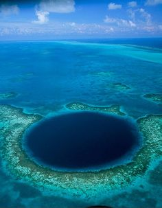 The Great Blue Hole is located off the coast of Belize; it is found in the middle of the Lighthouse Reef ecosystem. The Great Blue Hole is a underwater sinkhole that measures 984 feet (300 m) across. The sink hole plunges 394 feet (120 m) deep and provides divers with a crystal clear haven for exploring this underwater wonder.