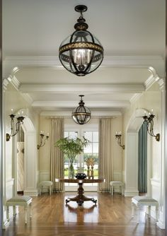 Grand entrance hall with beautiful floors, architectural details, wall sconces, chandeliers....looking through to French doors leading to back garden. lights, foyers, grand entrance, light fixtures, foyer design, entrance halls, hallway, entry hall, entryway