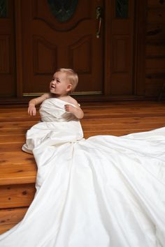 my daughter Elle in my wedding dress. I plan to take this picture every year. (2011 - 1 year old)