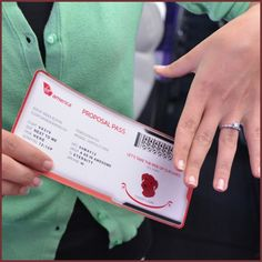 """A very creative spin on the usual boarding pass. James had a specially designed """"Proposal Pass"""" made for travel from """"here"""" to """"eternity."""" Even their dog, Conner, made a cameo."""