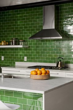 Shiny clover green tiles create a relaxing space in this DISC Interiors designed kitchen. #hardtofind #tiling #kitchen #green