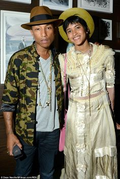 Style chameleons: Pharrell Williams and his kooky wife Helen Lasichanh attended the Phillips dinner for Tracey Emin and MOCA in North Miami ...