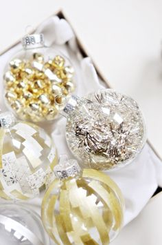 fill glass ornaments with tinsel, bells and festive objects