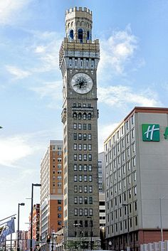Bromo Seltzer Tower. The building's most distinctive feature are the four clock faces adorning the tower, on the North, South, East and West sides. The clock faces are adorned with the letters B-R-O-M-O S-E-L-T-Z-E-R, while the Roman numeral numbers are less prominent. From street-level to rooftop, the tower stands 288.7 feet high, and was originally adorned with a 51 foot tall Bromo-Seltzer bottle, glowing blue and rotating. Due to structural concerns however, the bottle was removed in 1936