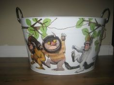 Mod Podge Children's book illustrations onto a bucket