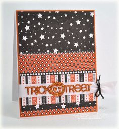 "handmade Halloween card ... display of fun prints in white, black and orange ... glittered die cut ""Trick or Treat"" ... luv the papers ... Paper Trey Ink"