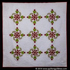 Best of show 2014: Coxcomb and Currants by Janet Treen.  Design Source: 19th Century vintage quilt, maker unknown.  2014 Quilters Guild of NSW.
