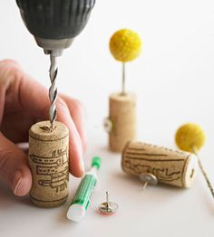 cork pushpins:Drill into the top of a wine cork (don't drill through the entire cork, though) to create a vessel. Use permanent glue to adhere a pushpin to the cork. Insert a dried flower or feather into the drilled hole and display on a bulletin board for fresh flair