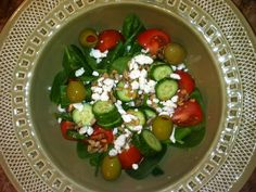 """How yummy does this look? My 4 year old and I shared our salad for lunch...he loved eating """"leaves"""" :)    2 cups spinach  2 small tomatoes  2 Persian cucumbers  Sprinkle with sunflower seeds and feta cheese  Olives (optional)  Add balsamic vinagrette    Delish! ♥"""