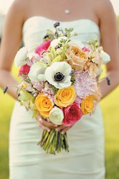 Gorgeous wedding bouquet featuring anemones, caramel antique roses and lavender flowers.