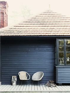 The black stained exterior cuts a dramatic profile.  A rambling cottage in East Sussex via remodelista.
