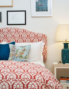 This bedroom from Diane Bergeron Interiors is a bit more coral / rust than the maroon I'm looking to incorporate, but I actually do like this color with the peacock blue.