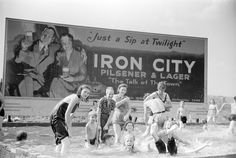 Pittsburgh Steelworkers' Kids in Homemade Swimming Pool, 1938 (Although the Iron City ad is just as interesting.  Iron City:  the beer you guzzle before bedtime!)