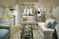 Candice Olson: Divine Design - blue & green attic living room design with white cream linen tufted sofa ...