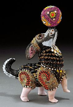 Besty Youngquist builds wonderful anthropomorphic sculptures with contemporary and antique beads from around the world and vintage porcelain doll parts and prosthetic glass eyes