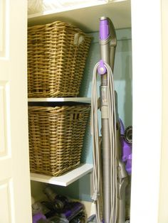 Linen Closet Organized...shelves off to the side to keep room for the vacuum. This would be a great solution for my linen closet!
