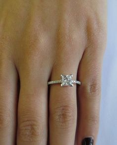 ... Princess cut diamond engagement ring. With thin sparkly pave band More