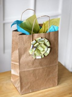 via How About Orange - recycle your yellow pages into a pretty gift bow