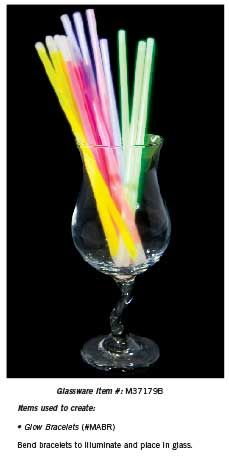 For a simple decoration add glow sticks to a glass. Be sure to bend and crack the glow sticks first so they light up.