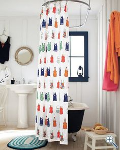 navy clawfoot tub with swimsuit shower curtain