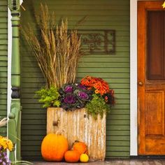 entry with a fall planter and pumpkins