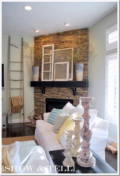 A ladder to hold all your extra throw blankets and old windows above the mantle