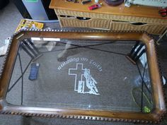 "Running on Faith Barrel Racer vinyl decal cut from etched glass material from www.DecalJunky.com applied to a glass coffee table. This customer said, ""Love the decal! Will be reordering!"" #rodeo #christian"