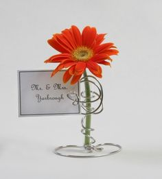 Cute!!!! Wedding place card holders with Gerber Daisy flowers from Etsy.