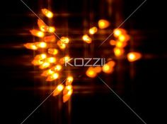 blurred view of orange halloween lights. - Blurred view of orange halloween lights over black background.
