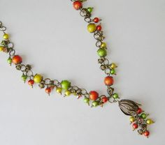 """APRIL CHALLENGE - Pop of Color.  """"Tutti Frutti"""" is a happy necklace of bright colorful glass Spectra beads, a quality brass tulip bead cap, and handmade chain ... just right for summer days!   See this and more new designs coming up at www.facebook.com/novegattidesigns"""