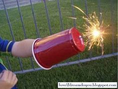 A plastic cup will keep little hands safe when handling sparklers on the Fourth of July.