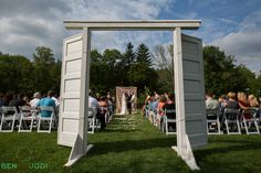 Beautiful ceremony outdoors at Happy Days Lodge.  Photo by Ben and Jodi Photography.  Doors from Borrow Vintage Rentals. Backdrop by With Love and Whimsy.