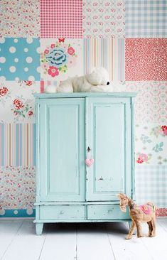 Scrapbook paper pack as wallpaper. It looks like a patchwork quilt wall.