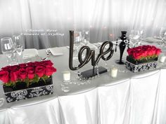 Black and White Head Table Decor for the Wedding Reception. Tables named, not numbered for the seating arrangements, or just for decoration.