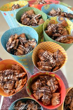 Chocolate Caramel Chex Mix in paper cones.