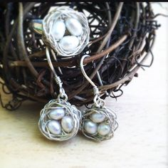Perfect little pearl eggs in a sterling nest