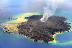 Nine mo. after a new island broke through the surface of the W Pa-cific Ocean, the volcanic eruption at Nishino-shima continues. The tiny new volcanic island (Niijima in Japanese) merged into Nishino-shima last winter & continued to grow. Steady flows of lava are enlarging the merged island, which is now 0.54 sq mi. 8/21/2014