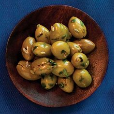 Cracked Green Olives from Sunset Magazine: Spanish Manzanilla Olives with Pits (crushed with the back of a wooden spoon) flavored with fennel seeds, orange peel, and tarragon