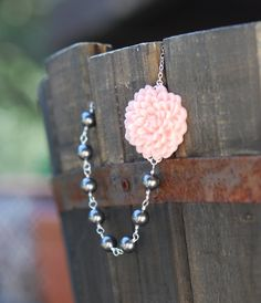 Gray pearl and pink flowered necklace.