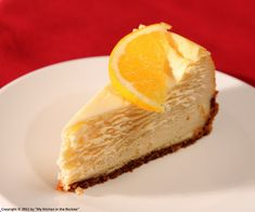 Orange Flavored New York Style Cheesecake by Kirsten | My Kitchen in the Rockies