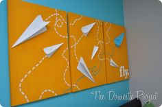 paper airplane art—good for a boy's bedroom.
