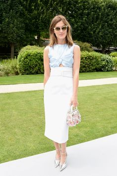 Hanneli Mustaparta charms us with her tiny purse with adornments and retro sunnies