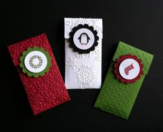 We made these cute gift card holders at my December stamp camps. They are made with Stampin' Up!'s Petite Pocket Die. (They are sooooo easy to make!!!) The images are from SU's Jolly Bingo Bits stamp set. I used the following embossing folders: Wreath/Petals-a-Plenty, Penguin/Northern Flurry, Stocking/Perfect Polka Dots. All supplies are from Stampin' Up!