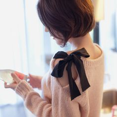 Off-the-shoulder bow sweater