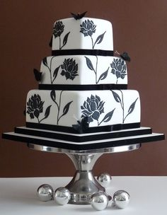 I think the black stencilling needs a bit more va-voom to suit your style, but thought you'd appreciate a 3 tier square cake! Would look nice with the damask stencilling to match the invites.