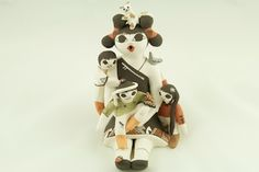 Storyteller Pottery by Judy Lewis from the Acoma Pueblo. http://www.treasuresofthesouthwest.com/storytellers-pueblo-pottery-dolls.html