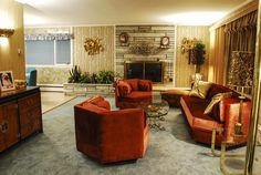 Roz House Family Room 2: Set of Roz's (played by Jennifer Lawrence) house.  The vintage ranch house had to be completely redone, except for the stone fireplace.  Every inch of the house was covered in vintage foil patterned wallpaper, carpeted, furnished and switched out with vintage appliances as seen in Columbia Pictures' AMERICAN HUSTLE.  Production Design by Judy Becker Photo by:  Alex Linde